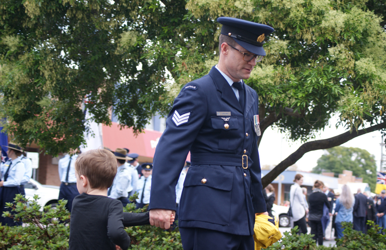 An Air Force member and his young son.