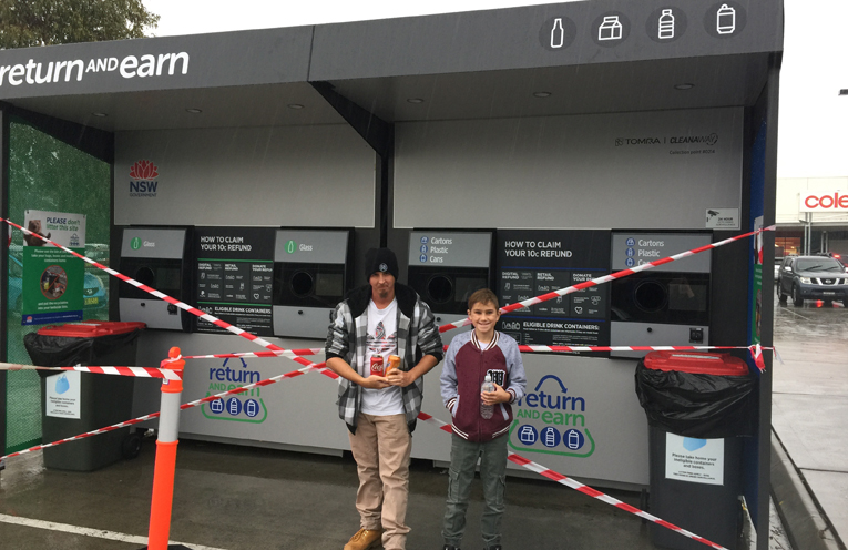 Jamie Brewster from the Tilligerry Youth Drop in Centre, with Malakai Wilcox at the Tilligerry machine while it is being set up.