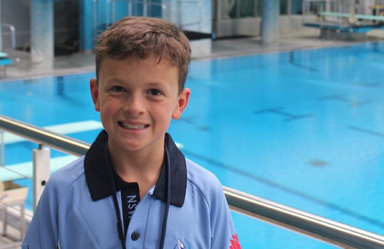 Joshua Lee in front of the diving boards.