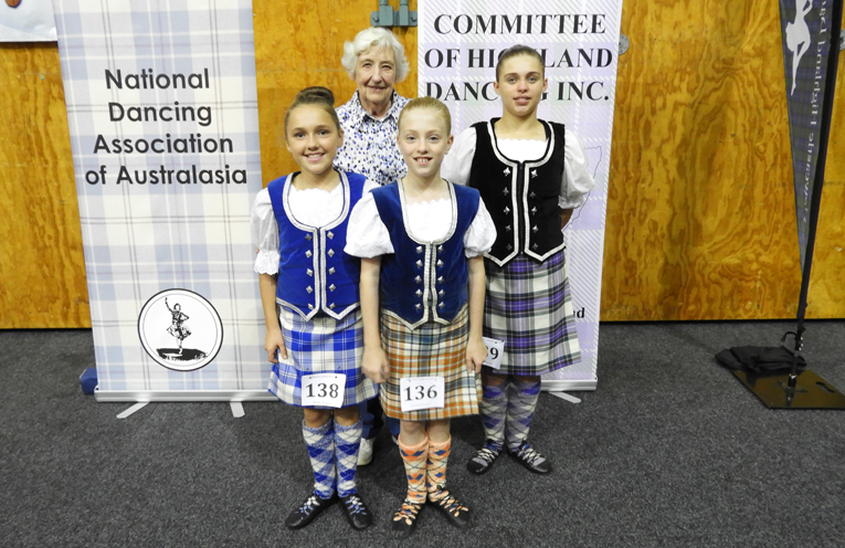 Bay Highland Dancers, Hope, Genevieve, and Larissa with their trainer Nance McLennan.