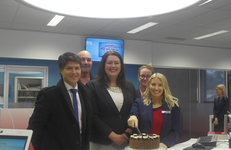 Minister Victor Dominello, Gavin Back from NSW Maritime, Councillor Jaimie Abbott, Branch manager Kristy Riley and Concierge of the bay Branch of Service NSW Lucy Simmons Cutting the cake to celebrate 50,000 customers served. Photo by Marian Sampson.
