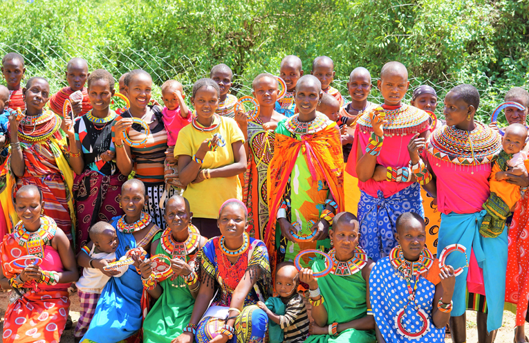 African women from the Mamas group in Kurungu, wearing some of the pieces they have created for Medowie Christian School students.