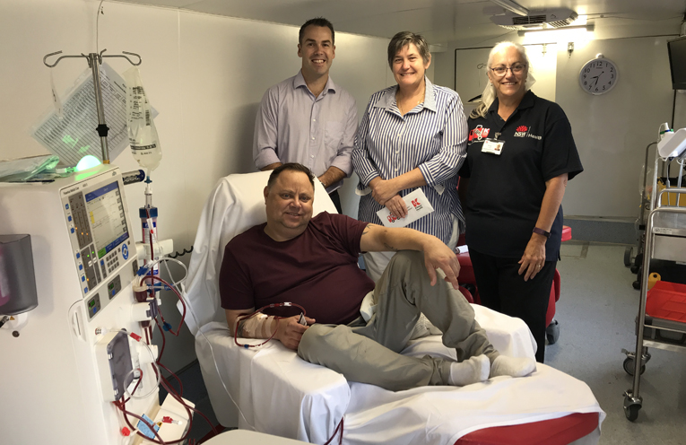 Port Stephens Mayor Ryan Palmer, Dungog Mayor Tracy Norman,  with dialysis patient Joel Williams and the Big Red Kidney Bus nurse Anna Flynn.