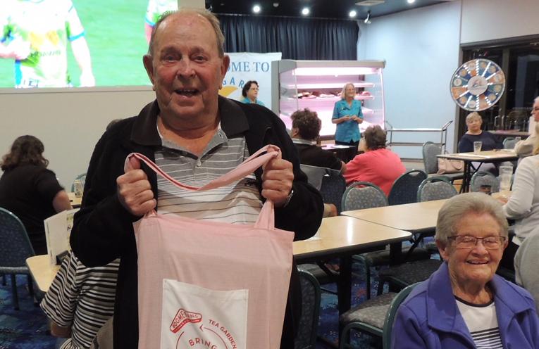 HAPPY RAFFLE WINNER: Warren Mankelow at Tea Gardens Country Club.