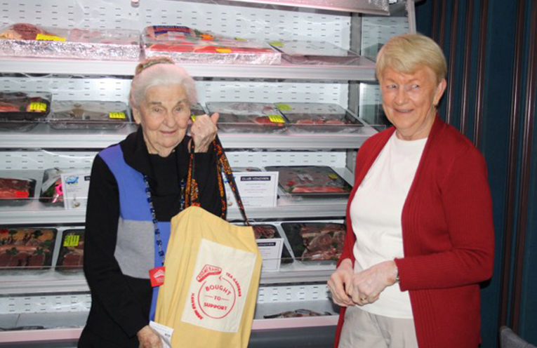 HAPPY RAFFLE WINNER; Linday Conway and Fran Henderson at HN Golf Club.