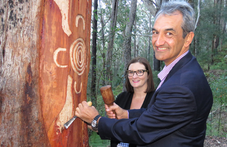 Head of Aboriginal Affairs Jason Ardler has a carving lesson with Minister Sarah Mitchell.