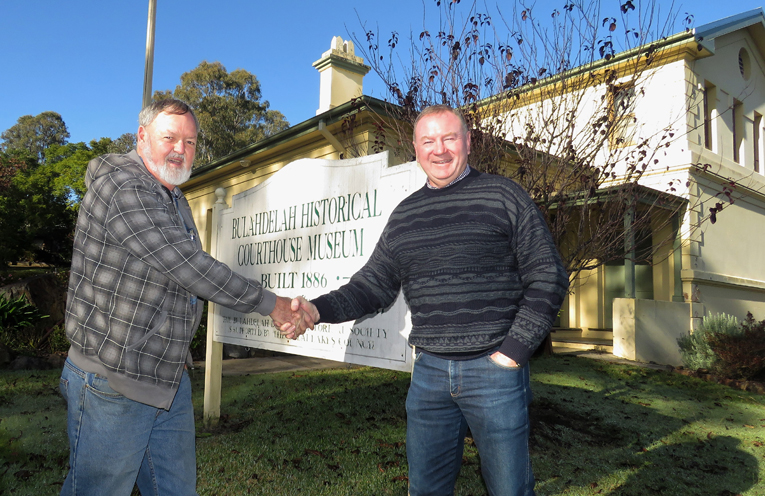 Bulahdelah Historical Society President Kevin Carter accepts the funding grant from Myall Lakes MP Stephen Bromhead.