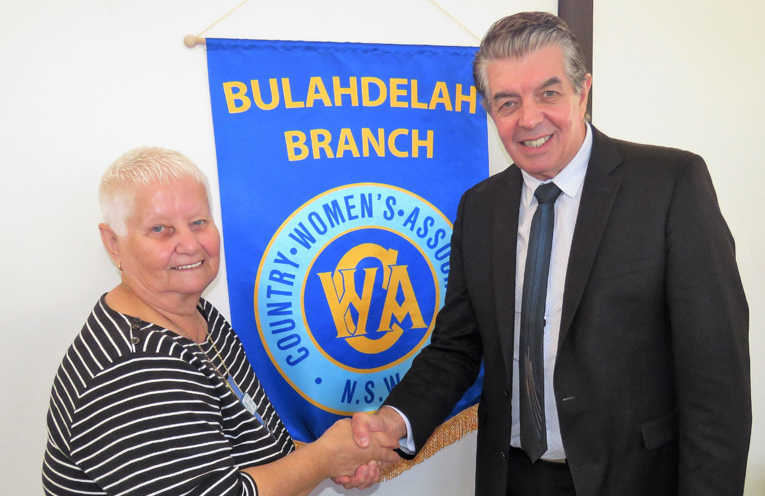 Branch President Lore Green accepts the donation from Minister for Disability and Volunteering Ray Williams.