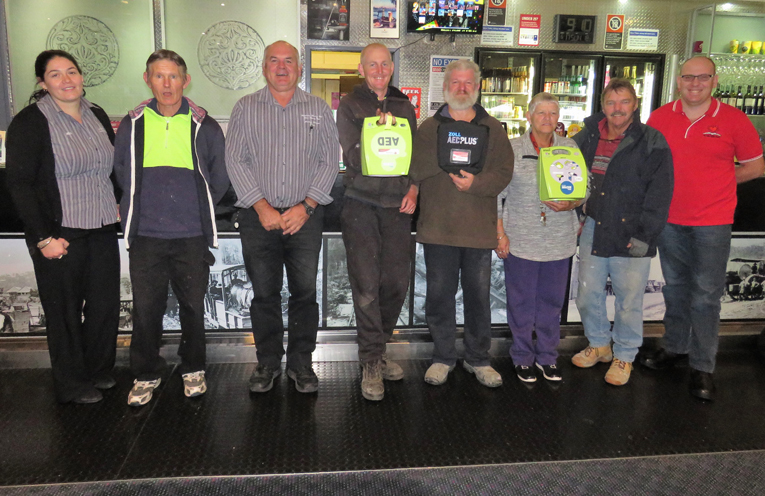 Bulahdelah Bowling Club staff with the new portable defibrillator.