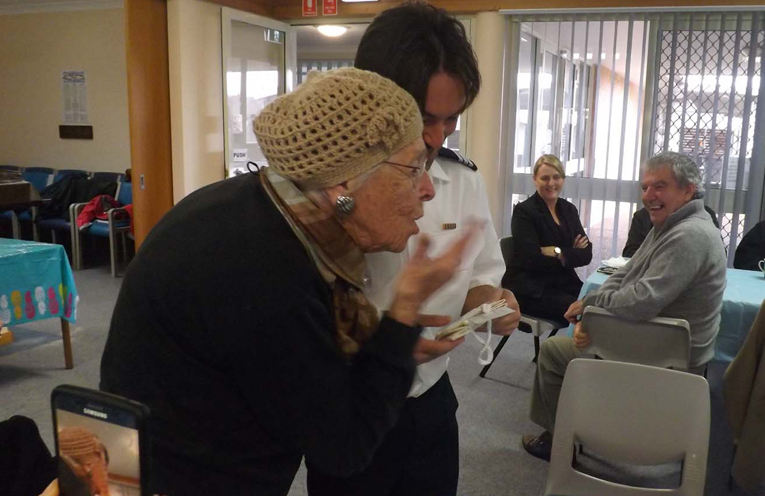 June wearing one of her own crochet hats is presenting Dean with the cheque for FBRFS.