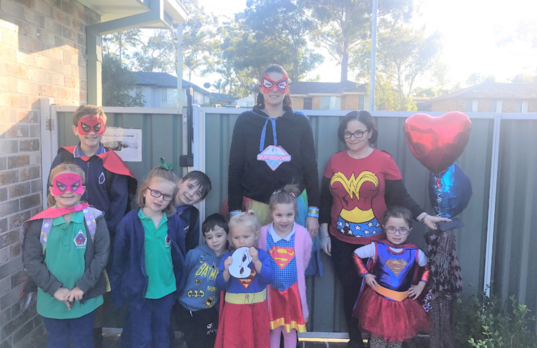 Kelly Berger with her mini superheroes at Kelly's Cottage day care.