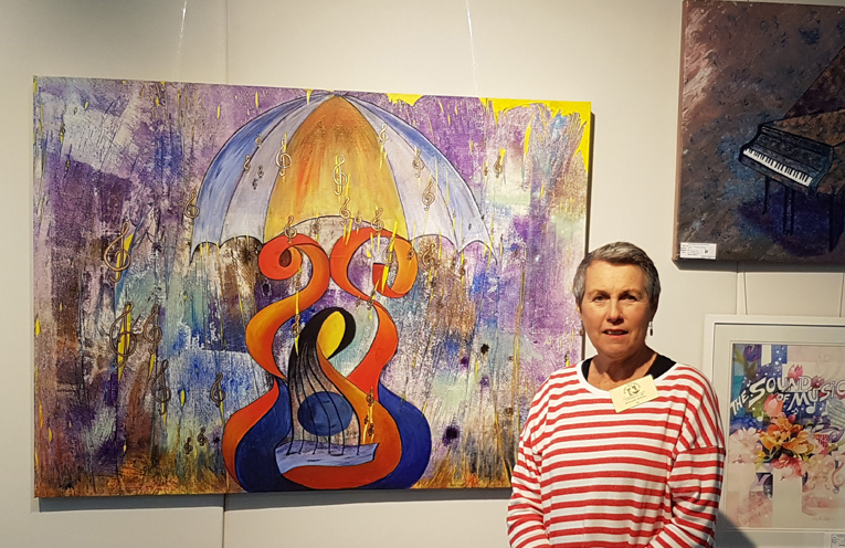 Artist Marianne Newton with her work in the Kaleidoscope of Colour Exhibition at the Port Stephens Community Arts Centre.