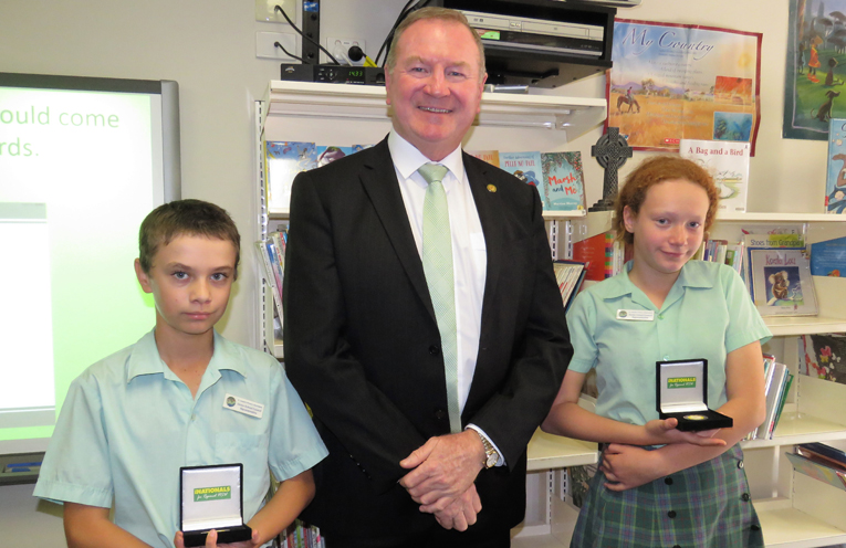 Myall Lakes MP Stephen Bromhead presents medals to student leaders Jordan Grills and Ellie Watson.