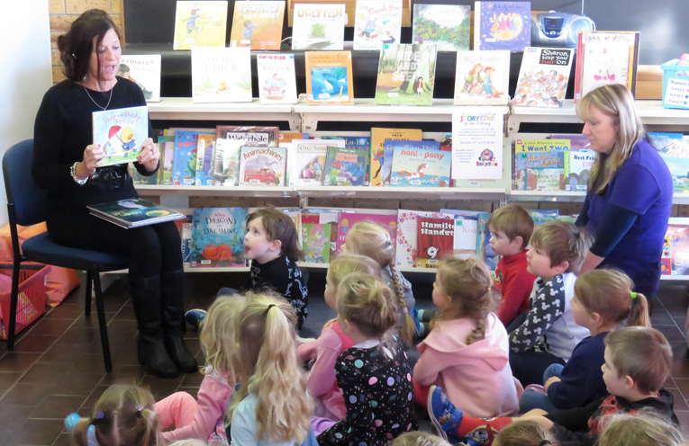 Storytime: Margaret King reads to the children.