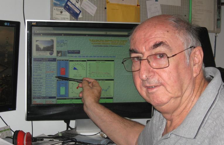 Local weatherman, Alan Gibson monitoring his site.
