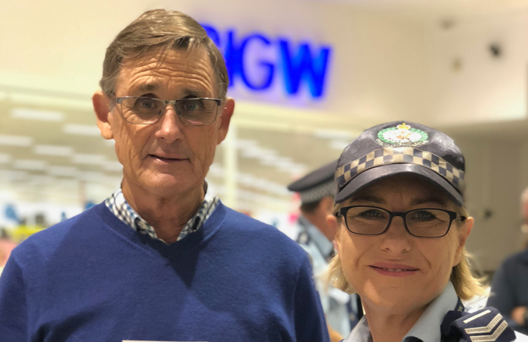 Geoff Dingle with Senior Constable Alison Stewart, and one of the new information magnets created by Medowie Neighbourhood Watch