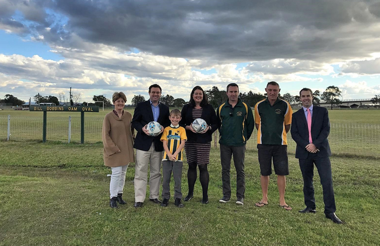 Catherine Cusack MLC and Port Stephen Mayor Ryan Palmer with representatives from Raymond Terrace Soccer Club.