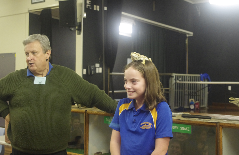 Snakes Tails Bob Withey with Tomaree Public School's Lexie Chesters and a Bearded Dragon. Photo by Marian Sampson.