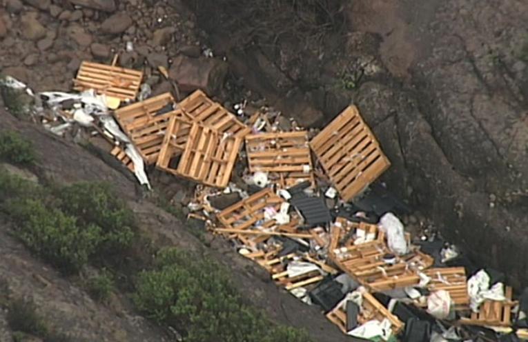 SALVAGE OPERATION: Debris on Yacaaba Headland.