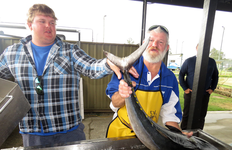 Tom Evans and Grant Bidgood weigh-in the 15.4kg Longtail Tuna.