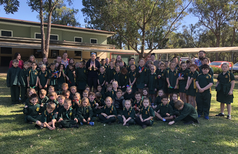 Natasha Scott with all students and teachers at Salt Ash Public School.