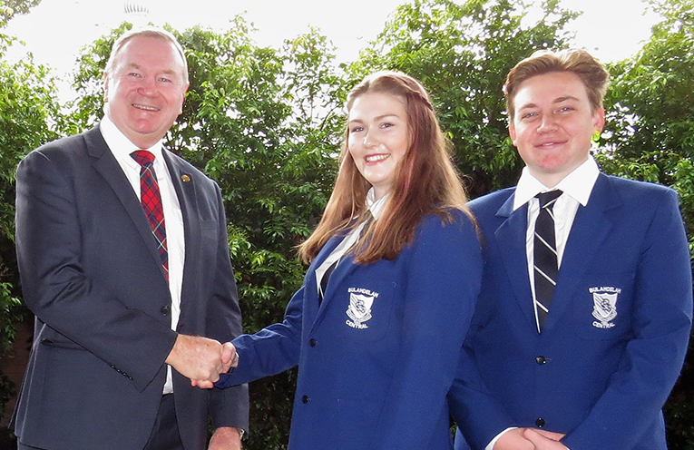 Member for Myall Lakes Stephen Bromhead congratulates Captains Ashleigh Dorney and Liam Garemyn.