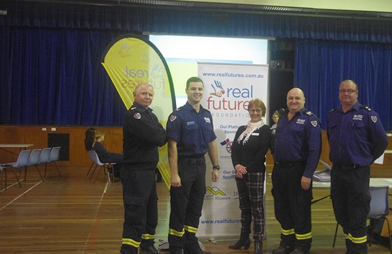 NSW Fire Departments Andrew Hall, Matt O'Donoghue, Peter McCabe and Matthew Braamall with Real Futures Foundation Program Manager Christina Noble at the Real Futures Foundation Careers Expo. Photo by Marian Sampson.