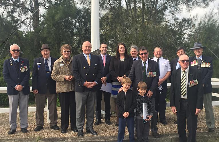 Mayor Ryan Palmer, Councillor Jaimie Abbott, MP David Elliott and RSL representatives and their families at the Seaham Knitting Circle War Memorial.