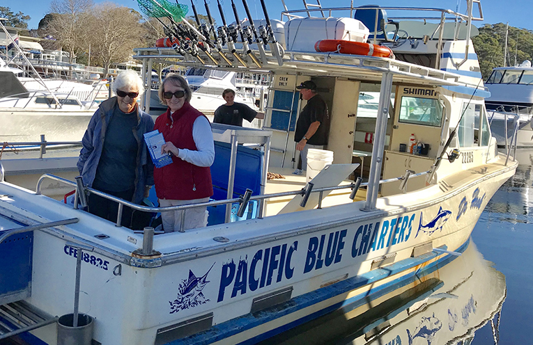 Mary Taylor with Val Spencer-Sun and the crew of Pacific Blue Charters Brendan Sampson and Brad Horn.