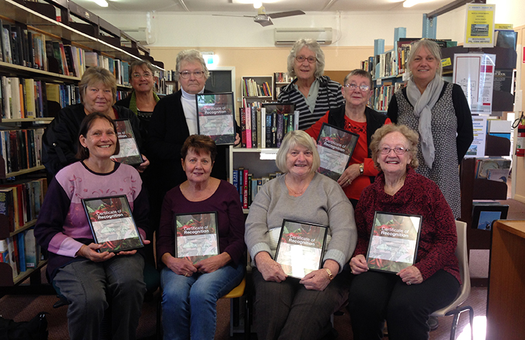 Vicki Bailey (back row, far right) with volunteers and their certificates.