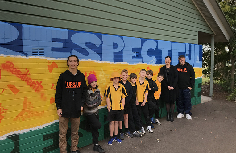 Medowie students, artists from Up&Up and Medowie Public School principal Mrs Allison Thompson in front of the new mural.