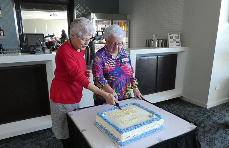 Charlotte Wood, a Foundation Member and Judith Berry, the newest member of the Club, cutting the birthday cake.