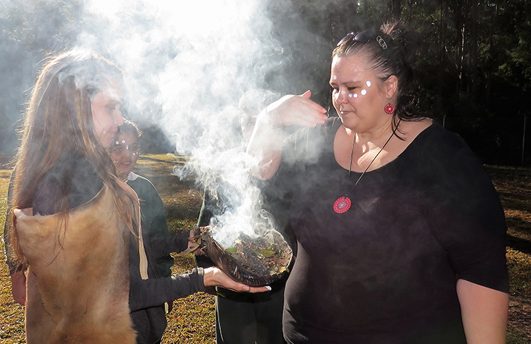 Parent Karrin Briffa takes part in the Smoking Ceremony at St Joseph's.