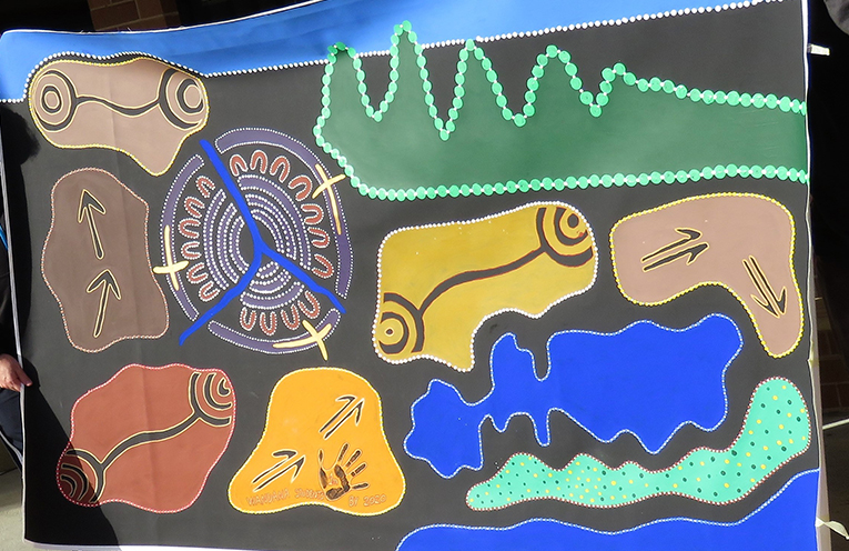 The mural painted by students at St Joseph's represents the local area.