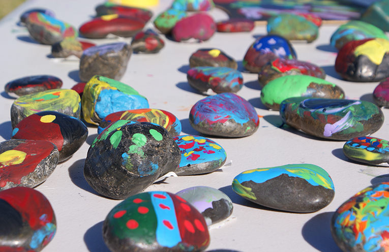 One stall at the Worimi family fun day allowed children to paint their own rocks. Photo by Stelbel Photography.