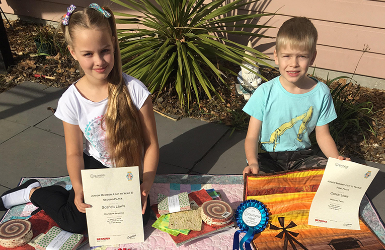Scarlett and Caesar Lewis with their award winning quilts.