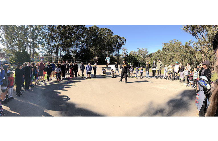 The crowd at Sunday's Snak n Rap form a circle to share important stories.