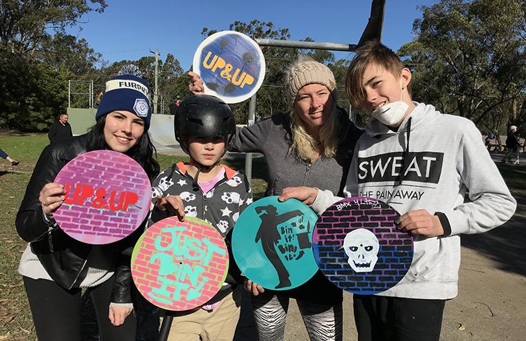 Thalia, Cameron, Jodi & Mitch sharing the Snak n Rap message, painting records.