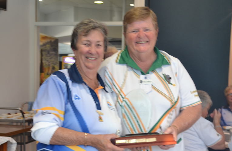 President Robyn Webster accepting The Trophy from Lemon Tree Passage's President Sharon Williams.