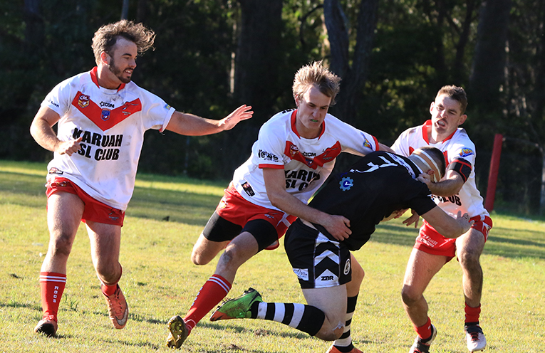 Adam Crampton making the tackle with Sam Croese and Kane Chisholme in assistants. Photo by Sharon Wedd
