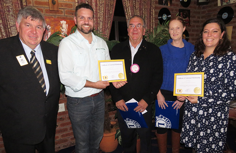 District Governor Glenn Byrnes with newly inducted Lions Ash and Aleesha Ray, President Arthur Baker and Lion Jess Gordon.