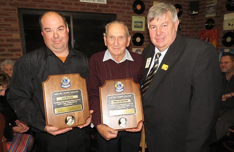 District Governor Glenn Byrnes presents Ian Mason and Phillip Mason with the Lions Club International Foundation Award.