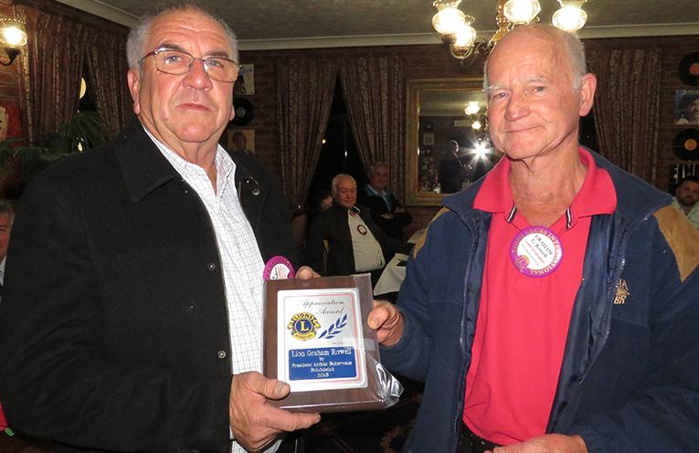 Lion Grahame Rowell receives an Appreciation Award from President Arthur Baker.