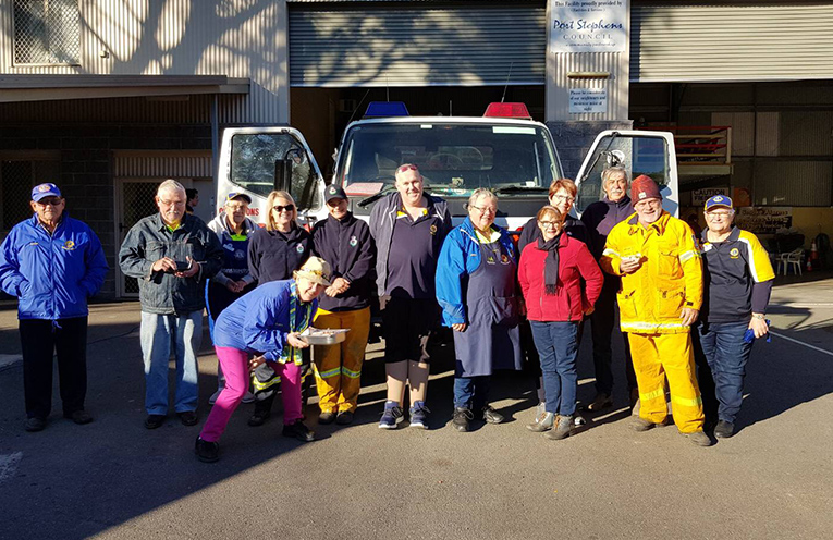 Medowie and Raymond Terrace Lions Club members on hand serving breakfast for the brigades.