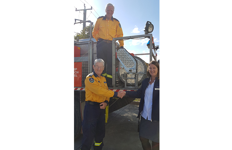 AUTOMATIC REEL DONATION: RFS Noel Quince, Peter Plain and Holiday Coast's Julie Hammond.
