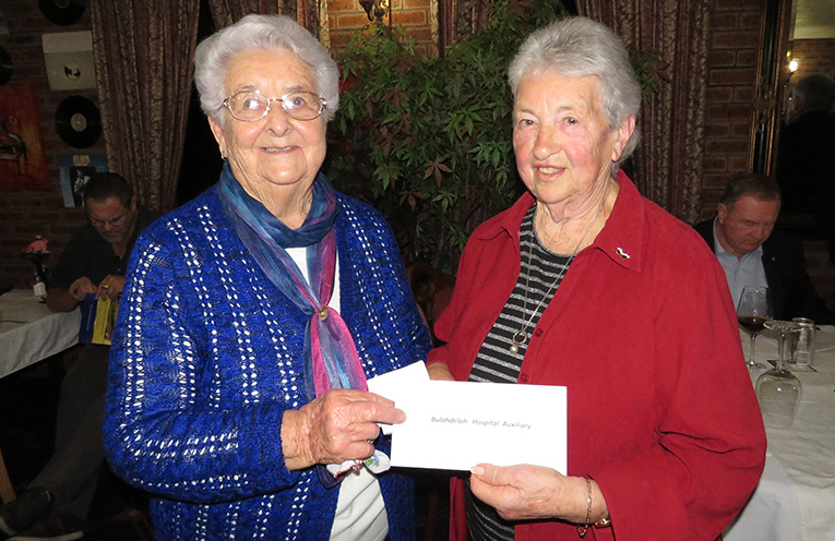 Lion Betty Baker presents the donation to Hospital Auxiliary President Irene Worth.