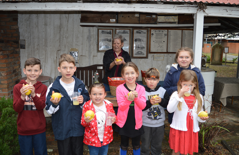 Participants from the Children's University join in the beverage making fun.