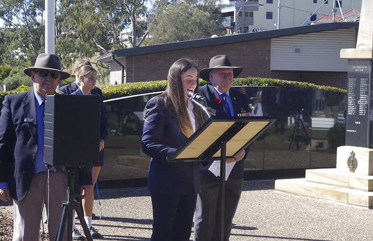 Rhiana Mackenzie of Tomaree High School giving the address at the 50th anniversary commemoration of the Battle of Long Tan. Photo by Marian Sampson.