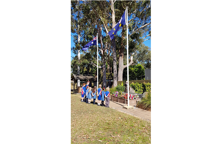 Wirreanda Public School students pause and reflect after laying their offering at the cenotaph.
