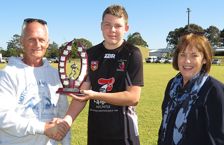 Stephen and Jenny Hoare present the junior trophy to BCS captain Angus Devon.